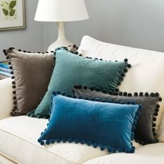 We paired our Signature Velvet with whimsical pom pom trim for a playful match made in pillow heaven. This cozy 20Square Pillow is made of luxurious cotton velvet blend with in jewel tones that layer in warmth and softness with a simple toss.