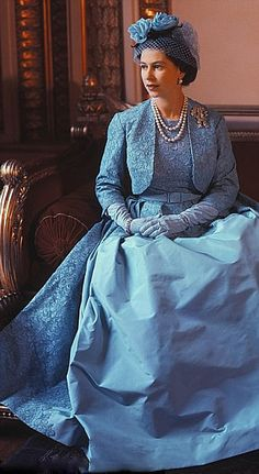 British Queen Elizabeth II wore Norman Hartnell on the occasion of her sister Princess Margaret's wedding on 6 May 1960