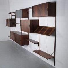For sale through RetroStart: Palisander 425 X 200cm Wall Unit from the fifties by Kai Kristiansen for FM Mobel | #42716