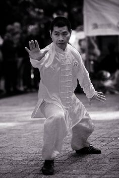 Kung fu performance in Kowloon park. Old film look.     here at the premiere Fredericksburg martial arts school at http://www.shaolinkungfucenter.com