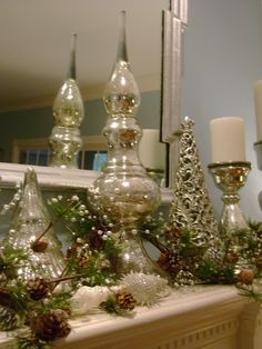 Mercury Glass Mantle   *   I love how mercury glass reflects everything! Especially Christmas Tree lights and candle light as the day fades...