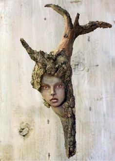 tatjana raum's polymer and driftwood. From Daily Art Muse.