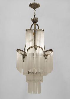 French Art Deco nickel plated chandelier with rope and tassel trim and tiered tubular glass drops