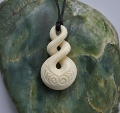 Eternal bonding symbol with Maori love engraving by JackieTump on Etsy