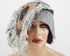 Felted Hat Designer Hat Art Hat wild hats Felt wearable art Nunofelt Nuno felt Fiber Art    I will make this hat for you in 7-14 days.    Much more beautiful than the picture! A hat from our workshop.  A feminine and gorgeous piece of art - it will emphasize your individuality!    Elegant and very flattering hat. Hand felted on and with silk (Nunofelt). Adapts to the head, it can be fancifully shaped and worn in countless ways. Full of motion, sophisticated, elegant, harking back to…