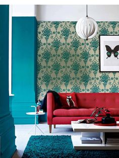 red sofa, patterned wallpaper, bold color