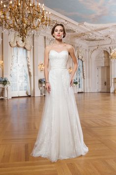 Bridal Manor | Sheath style Alecon and Venice lace dress with a soft tulle overlay and a sweetheart neckline.