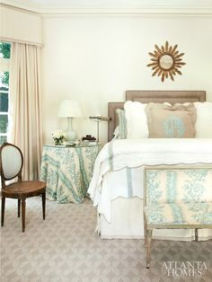 A blue-and-white Colefax & Fowler fabric sets the tone in the master bedroom. Leontine Linens dress the bed, a colorful counterpart to a custom headboard.