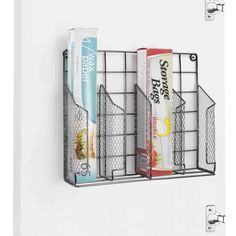 For a simple solution you don't have to DIY, this wall (or cabinet door) mounted kitchen wrap organizer from Bed Bath & Beyond (available for $12.99) is the perfect fix—it has space for four boxes of rolls or food storage bags and can go just about anywhere you need it to.