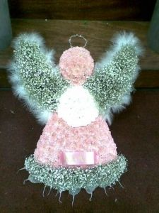 Standard size angel made for a childs funeral, can be made in a veriaty of flowers and colours,the wings are made of gypsy grass and feathers which gives the angel a delicate look. Hand delivered by Sue's Florist. Funeral Floral Arrangements, Unique Flower Arrangements, Unique Flowers, Casket Sprays, Funeral Tributes, Flower Spray, Funeral Flowers, Mesh Wreaths, Fun Crafts