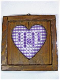embroidered heart broderie suisse with wooden frame.