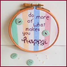 Do more of what makes you happy Cross Stitch design: http://www.sundownstitcher.co.uk/product/do-more-what-makes-you-happy-cross-stitch-embroidery-hoop #handmade #crossstitch #xstitch #design #happy #quote #buttons #craft #embroideryhoop #etsy #pretty #fabric