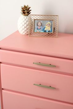 Go with a bold statement piece like this coral painted dresser to make a big impact in your toddler's room!