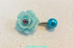 Belly button ring, belly button jewelry, bellybutton ring with blue rose, crystal chaton and pearl ball. $12.75, via Etsy.