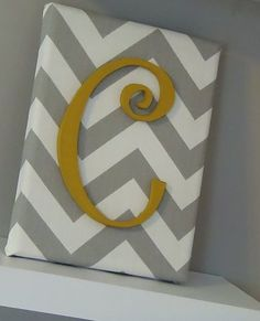 chevron fabric w/ monogram: Cover a frame with fabric using a hot glue gun. Paint monogram and glue to fabric.