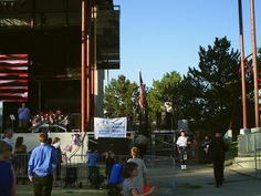 PT NAMPA IDAHO GOD AND COUNTRY FESTIVAL. 2 JULY 15 THE COLORS ARE TAKEN ON STAGE, THE 21 GUN SALUTE MEN STAND TO THE SIDE.