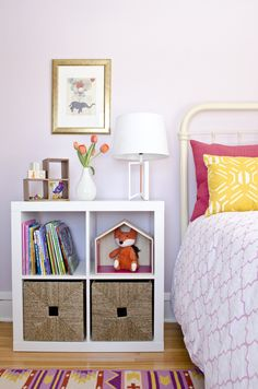 Bookshelf with storage used as a side table in this girl's bedroom makeover. #SWPaintingWeek @Sherwin-Williams