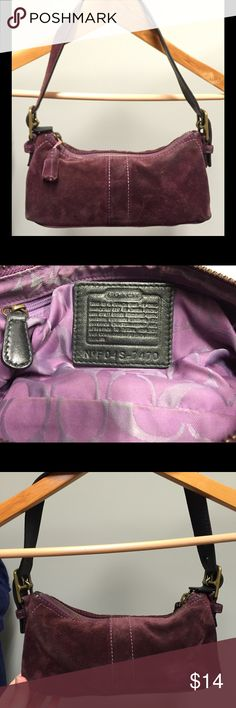 COACH purple suede baguette bag Preloved Coach bag in purple/burgundy suede. This is a great size bag which has gotten tons of use over the years. There is some wear and dirt on the suede including a larger stain of so sort shown in third pic. I cannot promise this will come out, but may come out or improve with a professional suede cleaning. Hang tag is missing and tassel hang (the strap not the tassel itself) has lost some suede finish. Inside is in great shape. Bag is priced based on this…