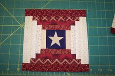 star is fussy cut for the center of this Courthouse Steps quilt block//would totally work for my americana/Texas Rangers lap quilt!!