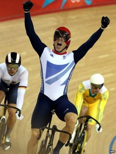 (Sir) Chris Hoy celebrates winning another gold medal.
