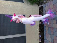 Unicorn costume. Streamers. Tutus on hands and feet.