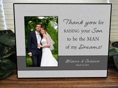This personalized grooms parents Thank you for raising the man of my dreams wedding picture frame measures 10 wide by 8 Tall and will accept a 4 x 6