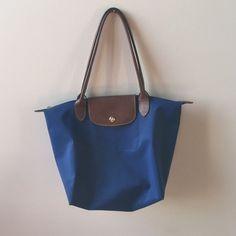 Blue longchamp bag Hardly used, longchamp bag! Longchamp Bags