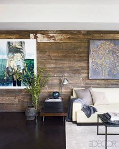 a living area wall, clad with planks of reclaimed barn wood.
