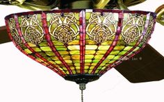 I've had a life-long love affair with Tiffany lamps. a ceiling fan with a Celtic Tiffany shade. Tiffany Ceiling Fan, Tiffany Lamps, Affair, Celtic, House Ideas, Life, Beauty, Beauty Illustration
