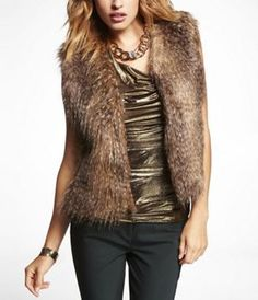"""FEATHERED FAUX FUR VEST at Express Since we care about the animals, """"FAUX"""" is the way to go! (wink)"""