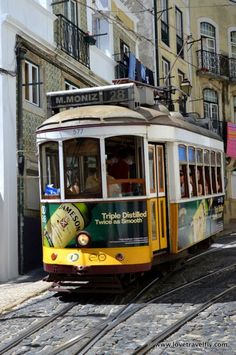 Yellow trams in Alfama, Lisbon, Portugal. Alfama is the oldest district of Lisbon, spreading on the slope between the São Jorge Castle and the Tejo river. (V)
