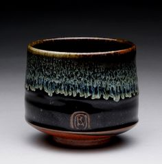 tea cup with black temmoku, wood ash and shino glazes; rmoralespottery