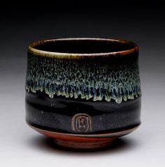 tea cup with black temmoku, wood ash and shino glazes; rmoralespottery