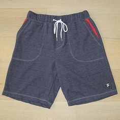 Boredshorts Navy/Red The Boredshorts are your everyday, go-to shorts for comfort and versatility. These super soft fleece shorts feature signature drawstrings and eyelets, woven accent labels, elastic waistband, and contrast pocketing and stitching. MADE IN USA.
