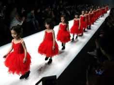 Girls present creations from the Sun Tomorrow Collection during Mercedes-Benz China Fashion Week in Beijing. Wu Hong, European Pressphoto Agency