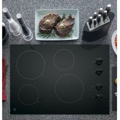 "JP3030DJBB in Black by GE Appliances in Maryland, MD - GE® 30"" Built-In Knob Control Electric Cooktop"