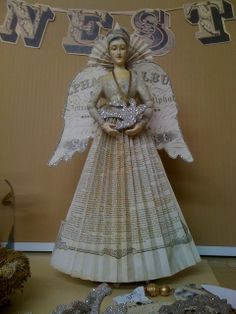 Angel with book page skirt