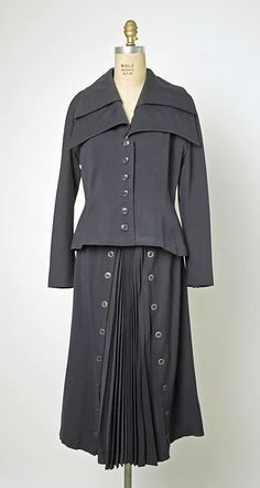 Suit -  wool  1947–48 Jacques Fath (1912–1954) *  Department Store:     Line for line reproduction by R. H. Macy & Co. (American)