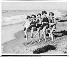 Five women in bathing suits dancing on the beach in Venice, California [s.d.] from the USC Digital Photo Archives - Los Angeles Area Chamber of Commerce Collection, 1890-1960.  (Specific date of photo apparently unidentified.)