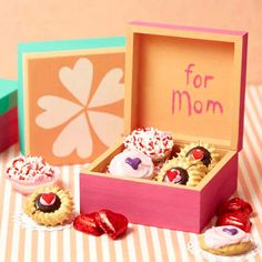 Painted Treasure Box......Customize a small wooden box to hold Mom's special treasures. Grab a purchased wooden box and paint the outside a bright color; let dry. Add embellishments or painted motifs to the top of the box, and carefully paint a sweet message inside. Fill the box with small sweets or some of Mom's favorite things.