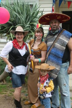The Family in Wild West gear - a Sheriff, a squaw, a Mexican and a little cowboy (Woody)