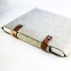 We've been looking for a more attractive way to file all those loose papers in our bags. Put this wool felt holder on our 'must-have' list.