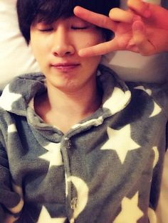 Group Super Junior's member Eunhyuk revealed a self-camera photo taken on his bed. http://www.kpopstarz.com/tags/super-junior