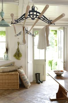 Our limited addition Elgan ceiling clothes airer dryer hanging in the laundry making good use of the ceiling space as the washing dries.