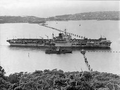 HMS Formidable going through the anti-submarine boom in Sydney harbor, Australia, photo taken from George's Head looking toward Green Point Source Australian War Memorial Identification Code. British Aircraft Carrier, Royal Navy Aircraft Carriers, Navy Carriers, Midget Submarine, Royal Australian Navy, In Harm's Way, Military News, Tug Boats, Ww2 Aircraft