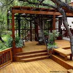 Designed and built around the existing landscape, this multilevel deck becomes a look-out-loft amidst the trees.