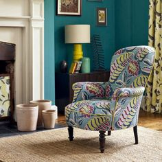 Bright statement armchair by fireplace | Statement Armchairs | Decorating Ideas | Red Online