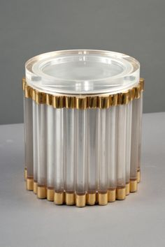 Italy, 1970s    Gabriella Crespi - ice bucket  Translucent plexiglass rods in a brass structure, inset with a plexiglass lid.