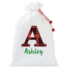 This cute personalized Plaid Letter Santa Claus Sack from Personalized Planet is the perfect way to present gifts on Christmas morning. Make this sack special for you and your family by adding a name to it for a custom look. Christmas Baskets, Christmas Gift Bags, Personalized Christmas Gifts, Christmas Stockings, Santa Sack, Antique Show, Santa Letter, Santa Gifts, Present Gift