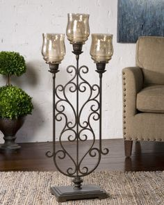 Fela Candle Holder This Floor Standing Candleholder Features A Hand Forged Ont Metal Base